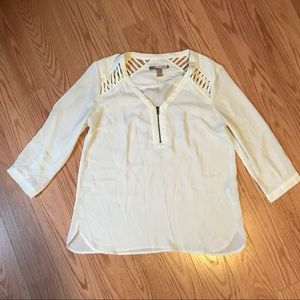 Pullover blouse with cutouts